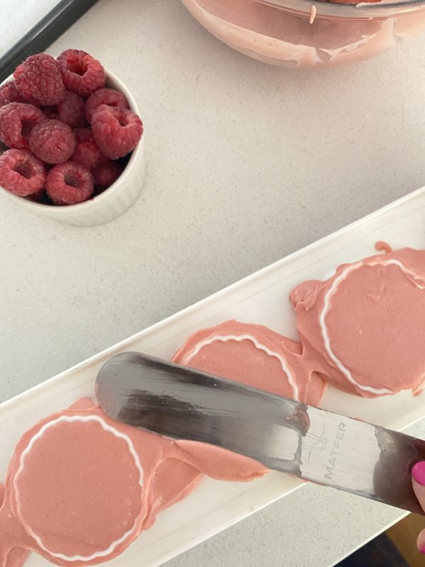 Raspberry & white chocolate mould scraping